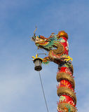 Light column dragon from Chinese Temple on sky background Stock Photos
