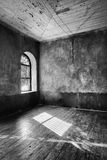Light coming through abandoned house's window Royalty Free Stock Photo