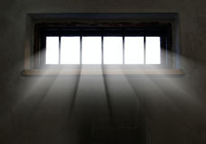 Light is coming through the barred window. Hope concept Stock Photos