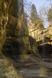 Light coming into the canyon. Tonti Canyon as the sun lights up the gentle waterfall at Starved Rock, Illinois Royalty Free Stock Photos
