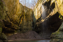 Light coming into the canyon. Tonti Canyon as the sun lights up the gentle waterfall at Starved Rock, Illinois Stock Image