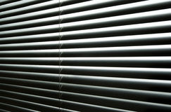 Light coming through closed metallic blinds Royalty Free Stock Image