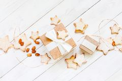 Light composition with gift box and cookies royalty free stock image