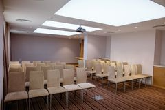 Light conference room with blue walls and chairs on hire. Light bright conference room with blue walls and chairs on hire Royalty Free Stock Photography