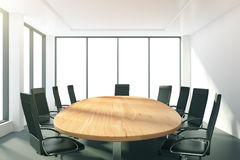 Light conference room with oval wooden table Royalty Free Stock Photo