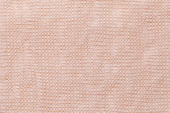 Light coral background closeup. Structure of the fabric macro Royalty Free Stock Photo