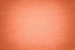 Light coral background from a textile material. Fabric with natural texture. Backdrop stock photo