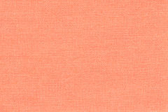 Light coral background from a textile material with wicker pattern, closeup. Stock Photography