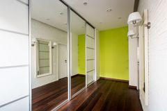 Stylish design of the corridor with mirrors. A light corridor in which there is a wardrobe with large mirrors Royalty Free Stock Photos