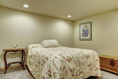 Clean And Bright Basement Bedroom With White Walls And Carpet