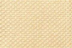 Light cream textile background with checkered pattern, closeup. Structure of the fabric macro. Stock Photography