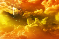 Light from crucifix or cross in golden dreamy heaven sky. God and Jesus Christ Stock Images
