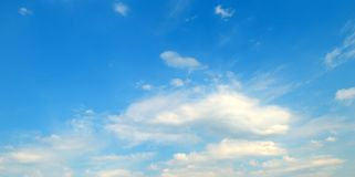 Light cumulus clouds against the blue sky. Wide photo. Light cumulus clouds against the blue sky. A bright sunny day. Wide photo Stock Images