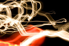 Light curves. Abstract wavy light curves on black background Stock Photos