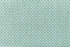 Light cyan textile background with checkered pattern, closeup. Structure of the fabric macro. Royalty Free Stock Photography