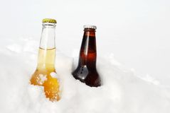 Light and dark beer in the snow Royalty Free Stock Images