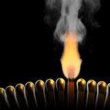 Light in the dark. Burning match in the row of matches. Hi-res digitally generated image Royalty Free Stock Photography