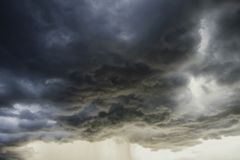 Light in the Dark and Dramatic Storm Clouds background. Black cumulus clouds before the beginning of a strong storm atmosphere backdrop beautiful blue bright royalty free stock images