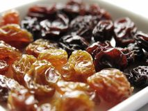 Light and Dark Raisins. A closeup of light and dark raisins on a small plate Stock Photo