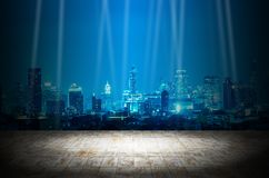 Light in dark room with night modern city building background.  stock image