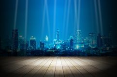 Light in dark room with night modern city building background.  stock photo