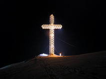 Light in darkness. White cross in dark background Royalty Free Stock Photography