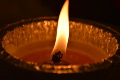 Light in the darkness. A candle light shining in the dark. High quality Stock Photos