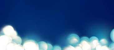 Light in a defocused. Spots Boke on Blue Colors Abstract Background Royalty Free Stock Image
