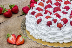 Light, delicate and tasty cream cake with fresh strawberries (half cake) Stock Photography
