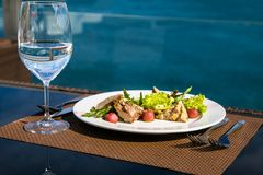 Meat salad and glass of still water. stock photography