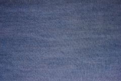 Texture blue denim fabric. Royalty Free Stock Photo