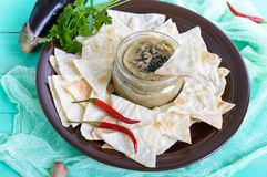 Light dietary pate from eggplant. Baba ganush is an Asian dish. Serve with thin lavash on a ceramic bowl stock photography
