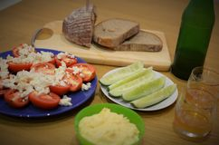 Light dinner. With vegetable as cucumber, tomato plus egg smash, bread and cheese Stock Photo
