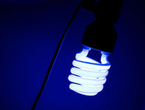 Light of dirty bulb with dark blue  still life Royalty Free Stock Image