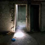 Light at door opening. Door opening with light in the basement of a construction site royalty free stock photo