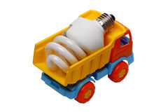 Light on the dump truck. Energy saving light bulb in a child's toy dump truck, isolated on white background Royalty Free Stock Image