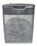 Light duty paper shredder. With metal wire basket filled with document shredding, isolated on white Stock Images