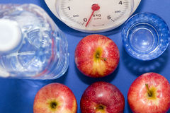 Light eating. Apple, water and balance Stock Images