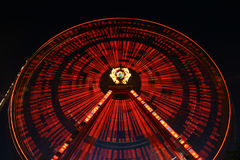 Light effect. Lunapark giant spinning wheel in motion Stock Photos
