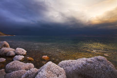 The light effects on the Dead Sea. Improbable light effects during a thunder-storm on the Dead Sea royalty free stock photo