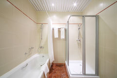 Light, empty and clean bathroom. With white bath and shower cabin Stock Photography