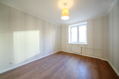 Light empty room with luster and light window Stock Photography