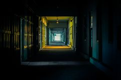 Light at the end of the hallway. In dark colors Stock Photography