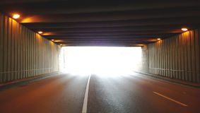 The light at the end of a modern road tunnel Stock Photos