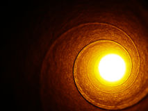 Light at the end... Paper roll with a bright light at the end Royalty Free Stock Images