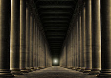 Light at end of row of pillars Stock Photography