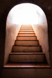 Light at the end of staircase. Light at the end of old staircase stock photo