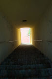 Light at the end of stairways tunnel Royalty Free Stock Photography
