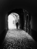 The Light at the End of the Tunnel. Elderly man with a walking stick Royalty Free Stock Photos
