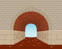 Light at the End of the Tunnel. An old style brick tunnel with Light at the End. There is an arch, a cracked brick and dirt floor Stock Photos